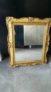 gold antique effect mirror in