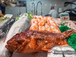 Various seafood for sale at fish market ...