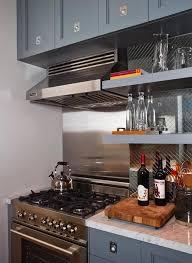 kitchen shelves on mirrored backsplash