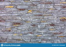 Aged Stone Fence Made Of Natural Stones Of Different Sizes Is Covered With Gray And Brown Paint Stock Image Image Of Gray Cobblestone 180673769