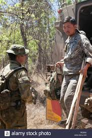 U.S. Army 2nd Lt. Jae Yu with the 25th Infantry Division, U.S. Army  Pacific, steps out of an Australian protected mobility vehicle after  Exercise Kowari 15 participants were relocated to their survival