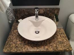 vessel sinks and granite countertops in