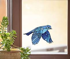 Amazon Com Bird Bluebird In Flight Stained Glass Style See Through Vinyl Window Decal Yadda Yadda Design Co Variations Available Med 5 75 W X 4 H Kitchen Dining