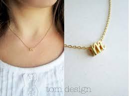 tiny gold cursive initial necklace
