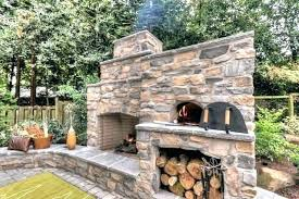 outdoor kitchen with pizza oven view in