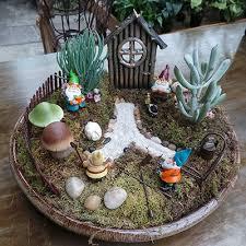 create a miniature fairy garden filled