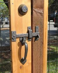 A Beautiful Gate Latch Drop Bar On A Custom Gate Fence Www Coastalbronze Com Door Handles Gate Latch House Gate Design