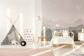 Patterned Teepee Standing In Bright Kids Room Interior With White Stock Photo Picture And Royalty Free Image Image 100063538