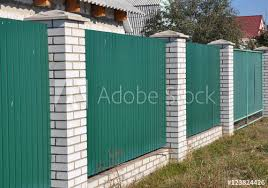 Green Metal Gate Fence With White Bricks Steel Sheets Fence Buy This Stock Photo And Explore Similar Images At Adobe Stock Adobe Stock