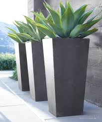 tall grey modern planters with images