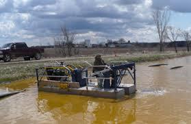 dredge barge boat vs hand dredging