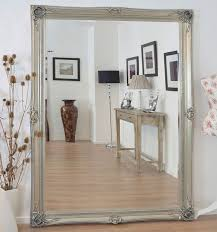 extravagant ornate wall mirror is a