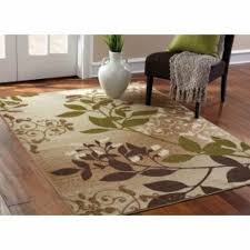tan off white sage green brown area rug
