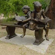life size child reading book statues