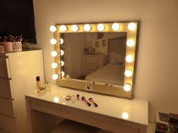 lighted vanity mirror and table