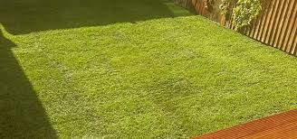 artificial turf laying garden lights