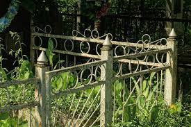 Part Of A Gray Old Metal Decorative Fence Made Of Iron Bars Overgrown With Green Grass Stock Photo Image Of Design Decoration 190864856