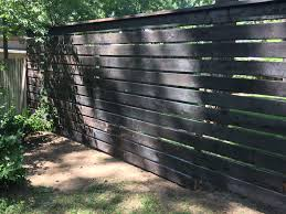 Shou Sugi Ban Horizontal Cedar Fence Used Steel Posts Pre Drilled And Screwed Each Board Into Posts One Inch Gaps Backyard Fences Wooden Fence Fence Design