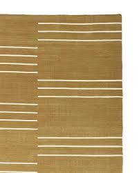 indio gold geometric striped dhurrie rug
