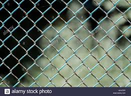 Chain Wire Fence Fence Made Of Steel Wire Mesh In Places The Rusted Wire Mesh Steel With Shabby Paint Stock Photo Alamy