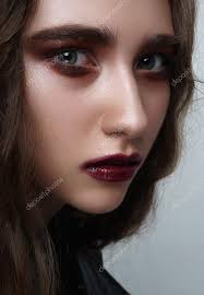young female rocker with dark red