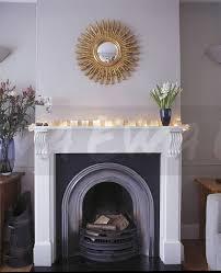 image gilt sunburst mirror above white