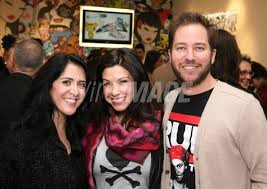 Tokidoki COO Pooneh Mohajer Katie and KROQ DJ Ted Stryker pose during...    WireImage   107507674