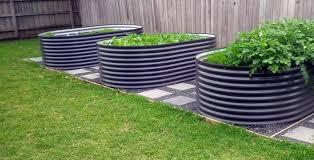 raised garden beds by waterline tanks