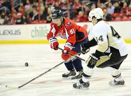 Washington Capitals defenseman Dmitry Orlov (81) goes for the puck against  Pittsburgh Penguins defenseman Brooks Orpik (