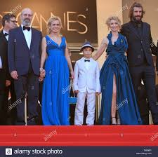 From L to R) William Hurt, Sandrine Bonnaire, guest, Alexandra Lamy and Augustin  Legrand arrive at the top of the red-carpeted steps of the Palais des  Festivals before the screening of the