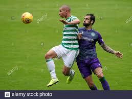 Celtic's Patryk Klimala (left) and Hibernian's Adam Jackson battle ...