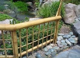Simple Bamboo Fence Around Our Koi Pond With Protective Animal Screen Lining Insides Wide Crisscross Fish Bamboo Garden Fences Fence Landscaping Bamboo Fence