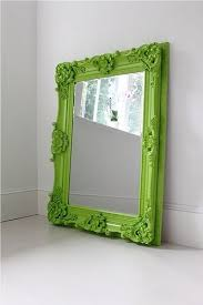 spray paint an old mirror frame in a