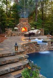outdoor fireplace with the pool
