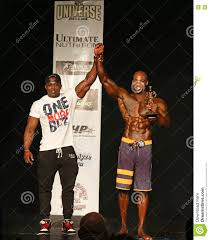 Bodybuilding Champ With Arms Raised And Trophy Editorial ...
