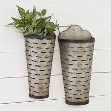 two tall olive vented wall pockets
