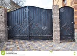 Installation Of Stone And Metal Fence With Door And Gate Stock Photo Image Of Paving Sheets 74558298
