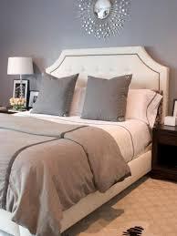 gray bedroom with sunburst mirror