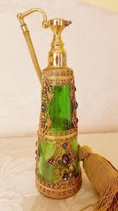 gold green glass perfume bottle