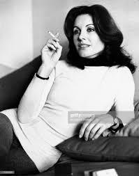 Italian television presenter and actress Gabriella Farinon smoking ...