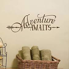 Amazon Com Battoo Adventure Awaits Wall Decal Quote Vinyl Lettering With Arrow Adventure Quote Travel Wall Decal Sticker 32 W 11 H Tribal Theme Room Decor Dark Brown Kitchen Dining