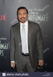 Aasif Mandvi arrives on the red carpet at the Netflix's premiere ...