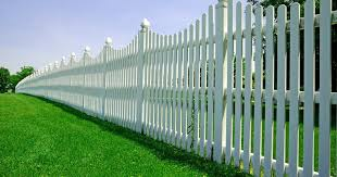 How To Prevent Grass From Growing Under Your Fence The Woodsman