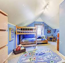 Bright Blue Kids Room With Vaulted Ceiling Furnished With Bunk Stock Photo Picture And Royalty Free Image Image 30283005