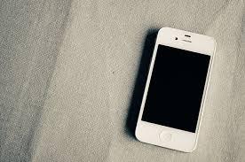 Royalty-Free photo: White iPhone 4 turned off | PickPik