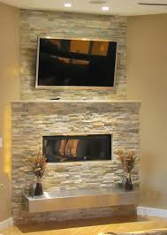 stacked stone fireplace with floating
