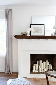 white brick fireplace simple styling