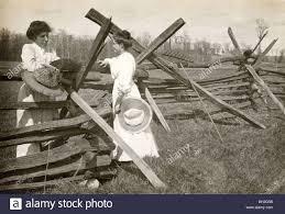 Two Women Gossiping At Split Rail Fence Stock Photo Alamy