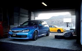 blue and yellow subaru wrx sti