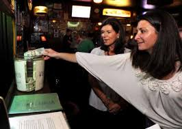 Marcy Haley, in back, looks on as Wendy Griffin, of... 349412 -  GreenwichTime